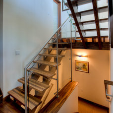 Contemporary Staircase by Treve Johnson Photography