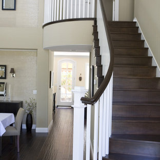 Inspiration for a large timeless wooden curved staircase remodel in San Francisco with wooden risers