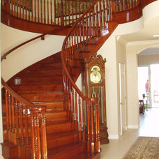 Traditional Staircase by Tuscany Builders
