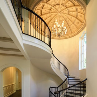 This is an example of a large victorian wood spiral staircase in Los Angeles with painted wood risers and mixed railing.