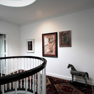 Inspiration for a large transitional wooden curved wood railing staircase remodel in Los Angeles with wooden risers