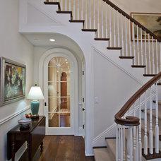 Farmhouse Staircase by Conrado - Home Builders