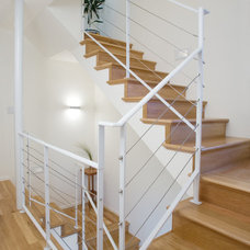 Contemporary Staircase by Valeant Architecture LLC