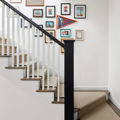 Mid-sized transitional wooden l-shaped wood railing staircase photo in Chicago with painted risers