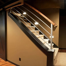 Traditional Staircase by DEICHMAN CONSTRUCTION
