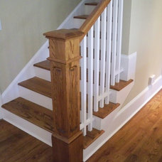 Traditional Staircase by Tropical Builders
