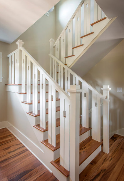 Traditional Staircase by Blue Sound Construction, Inc.