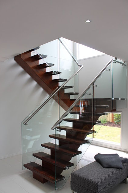 Contemporary Staircase by Orbit Homes