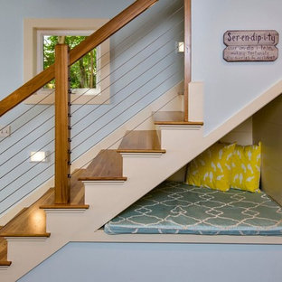 Inspiration for a mid-sized coastal wooden straight staircase remodel in Portland Maine with painted risers
