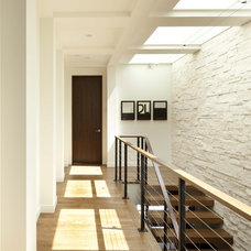 Contemporary Staircase by Charlie & Co. Design, Ltd
