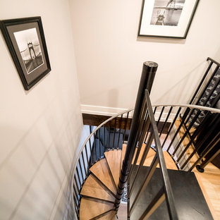 Staircase - small traditional wooden spiral metal railing staircase idea in Portland with metal risers