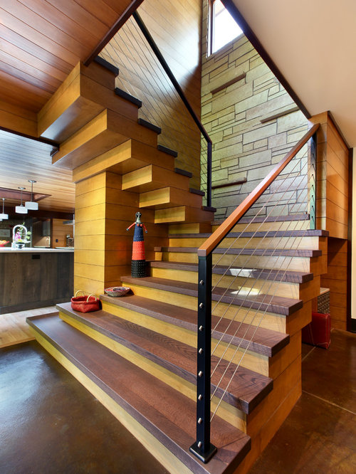 example of a large mountain style wooden ushaped staircase design in grand rapids