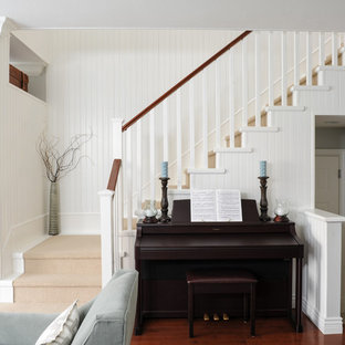 Small transitional painted straight staircase photo in Vancouver with painted risers