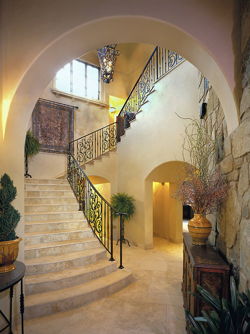 Example Of A Classic Travertine U Shaped Metal Railing Staircase Design In  Austin