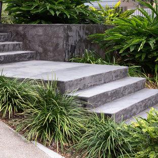 Ispirazione per una grande scala a rampa dritta minimalista con pedata in cemento e alzata in cemento