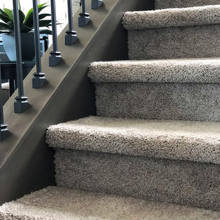 Example of a mid-sized arts and crafts carpeted u-shaped wood railing staircase design in Minneapolis with carpeted risers
