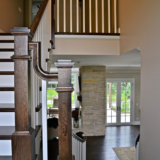 This is an example of a victorian wood u-shaped staircase in Chicago with painted wood risers.