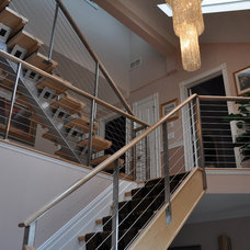 Contemporary Staircase by Woodbridge Builders