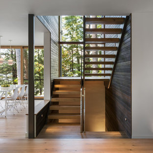 Design ideas for a rustic wood floating staircase in Boston with open risers.