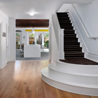 Inspiration for a large contemporary painted straight staircase remodel in New York with painted risers