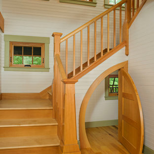 Small country wood u-shaped staircase in Boston with wood risers.