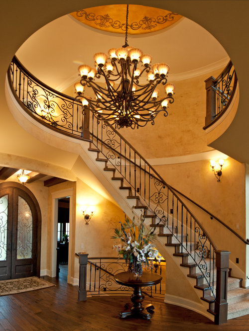 Example Of A Tuscan Wooden Curved Staircase Design In Vancouver