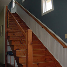 Traditional Staircase by Walsh Krowka & Associates, Inc