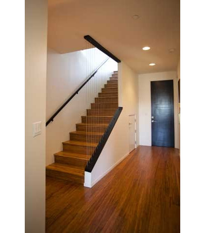 Contemporary Staircase by Isaman design, Inc.