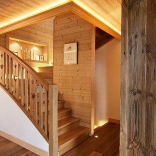 Modelo de escalera rural con escalones de madera y contrahuellas de madera
