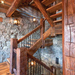 This is an example of a rustic wood staircase in Other with open risers.