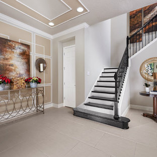 Inspiration for a large eclectic painted l-shaped staircase remodel in Orlando with wooden risers