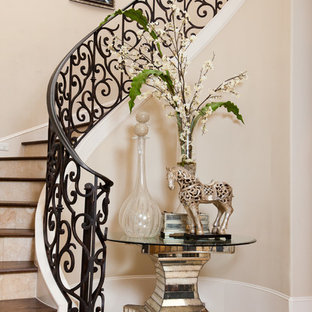 Example of a tuscan wooden curved staircase design in Houston