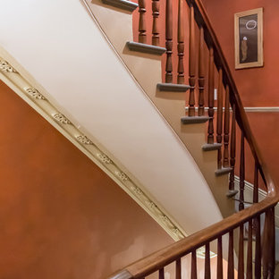 Staircase - eclectic wood railing staircase idea in Boston