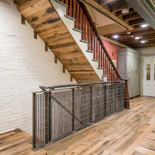 Ejemplo de escalera recta, ecléctica, con escalones de madera y barandilla de varios materiales