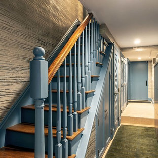 Example of a mid-sized transitional wooden straight mixed material railing staircase design in Austin with wooden risers