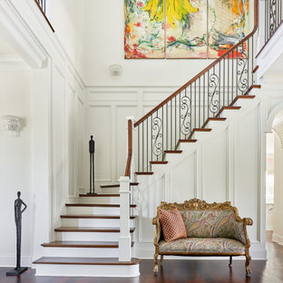 Transitional wooden l-shaped mixed material railing staircase photo in Charleston with painted risers