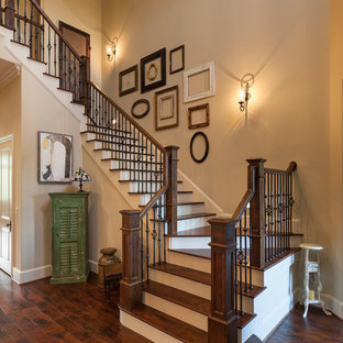 Example of a classic wooden u-shaped staircase design in Houston with painted risers