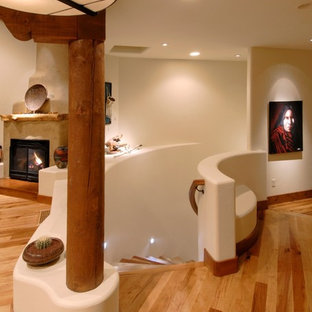 Inspiration for a mid-sized southwestern wooden curved staircase remodel in Denver with wooden risers