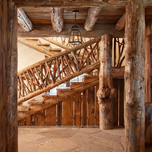 Inspiration for a rustic wood u-shaped staircase in Other with wood risers.