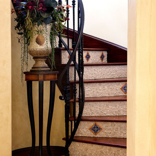 Mediterranean wood curved staircase in Orlando with tiled risers.