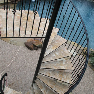 Inspiration For A Timeless Tile Spiral Open Staircase Remodel In Houston