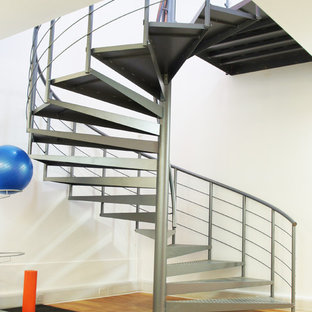 Inspiration for an expansive industrial metal spiral staircase in Hampshire with open risers.