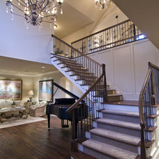 Traditional Staircase by Schrader & Companies