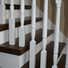 Traditional Staircase by Vision Stairways and Millwork