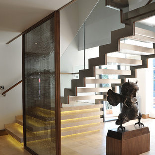 Photo of a mid-sized contemporary floating staircase in London.