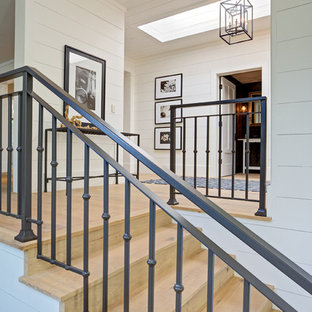Inspiration for a mid-sized farmhouse wooden straight staircase remodel in San Francisco with wooden risers