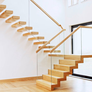 This is an example of a contemporary staircase in London with open risers.