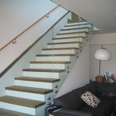 Contemporary Staircase by Jim Lowe Glass, LLC