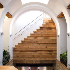 Rustic Staircase by Sullivan, Goulette & Wilson Ltd. Architects