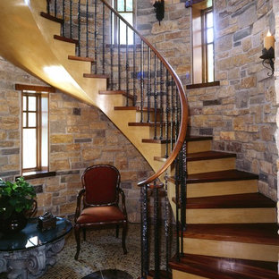Example of a mid-sized classic wooden curved wood railing staircase design in Minneapolis with wooden risers